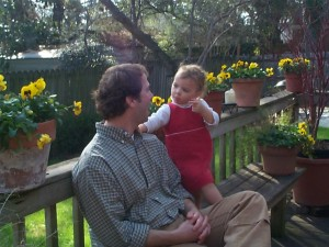 Chatting up Daddy on her birthday in 2005.